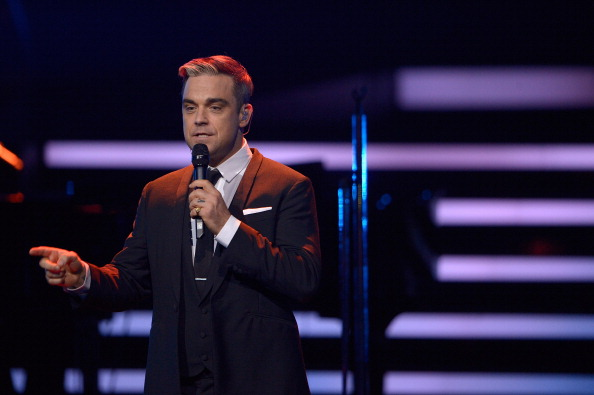 Robbie Williams performs on stage at the Bambi Awards 2013 at Stage Theater on November 14, 2013 in Berlin, Germany.  (Photo by Luca Teuchmann/Getty Images)