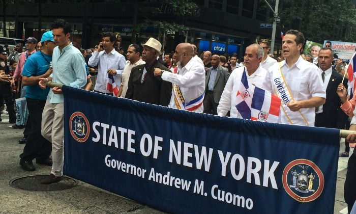 New York Gov. Andrew Cuomo (R) marching in the Dominican Day Parade in New York City on Aug. 10, 2014. (Jonathan Zhou/Epoch Times)