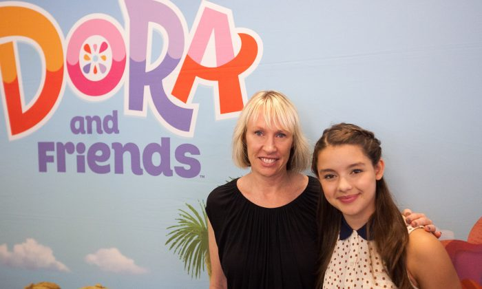 "Fátima Ptacek (R), the voice of Dora from TV series ""Dora the Explorer,"" and Valerie Walsh Valdes, co-creator of the show, pose for a picture at a screening of a spin-off show ""Dora and Friends: Into the City,"" at Children's Museum of Manhattan, in New York, Aug. 10, 2014. (Petr Svab/Epoch Times)"