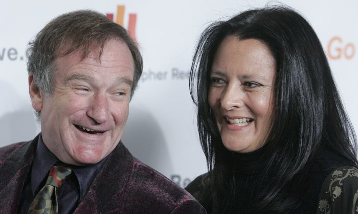 Robin Williams laughs with his now ex-wife Marsha Garces Williams as they arrive at the Christopher Reeve Foundation's A Magical Evening gala Thursday, Nov. 17, 2005 in New York. (AP Photo/Stephen Chernin)