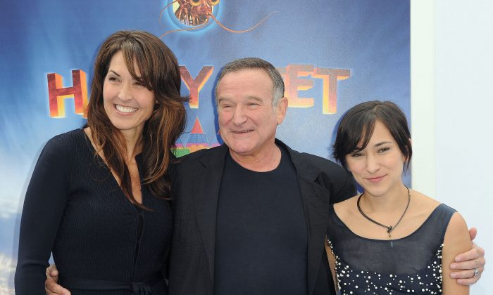 "Susan Schneider, from left, Robin Williams, and Zelda Williams arrive at the premiere of ""Happy Feet Two"" at Grauman's Chinese Theater, Sunday, Nov. 13, 2011, in Los Angeles. (AP Photo/Katy Winn)"
