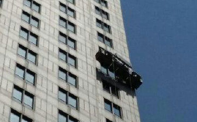 Two workers were rescued from the scaffolding on the 21st floor of a building in Manhattan, New York, on Monday, August 10, 2014. (New York Fire Department)