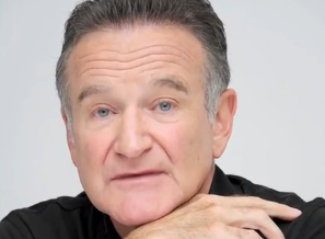 Robin Williams has committed suicide, according to reports. However, Robbie Williams--the singer--is still alive. (AOL Screenshot)