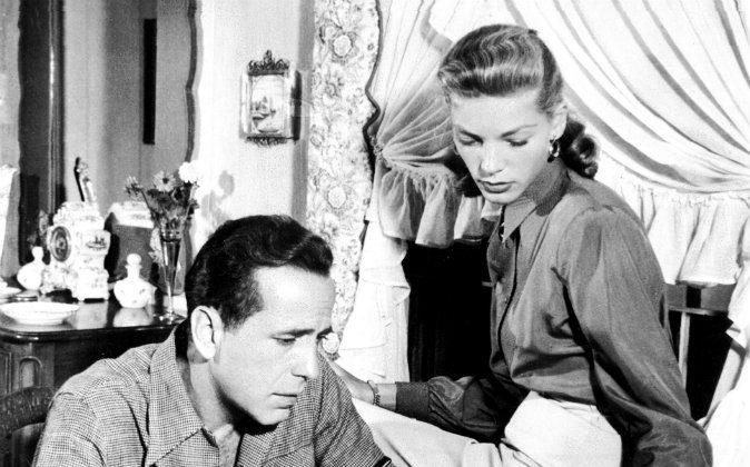 Humphrey Bogart (1899-1957) beside his wife U.S. actress Lauren Bacall, 1948. (CORR/AFP/GettyImages)