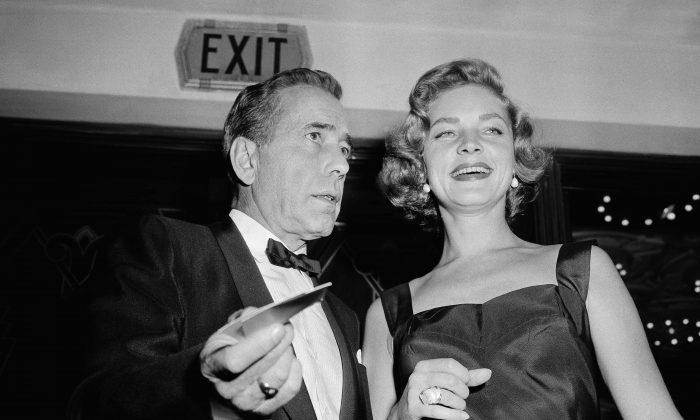 """This Oct. 12, 1955 file photo shows actors Humphrey Bogart, left, and his wife, Lauren Bacall at the premiere of """"The Desperate Hours,"""" in Los Angeles. (AP Photo/Harold Filan, FIle)"""