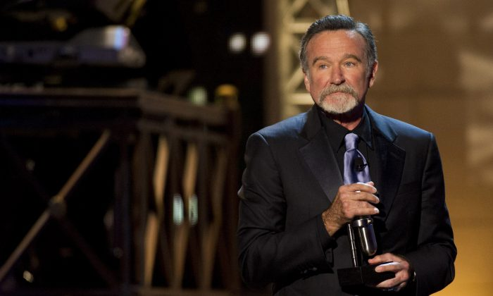 Robin Williams appears onstage at The 2012 Comedy Awards in New York, Saturday, April 28, 2012. (AP Photo/Charles Sykes)