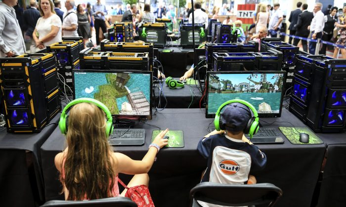 Young racegoers play in a Minecraft tournament at Ascot Racecourse in Ascot, England, on Aug. 9, 2014. (Miles Willis/Getty Images for Ascot Racecourse)