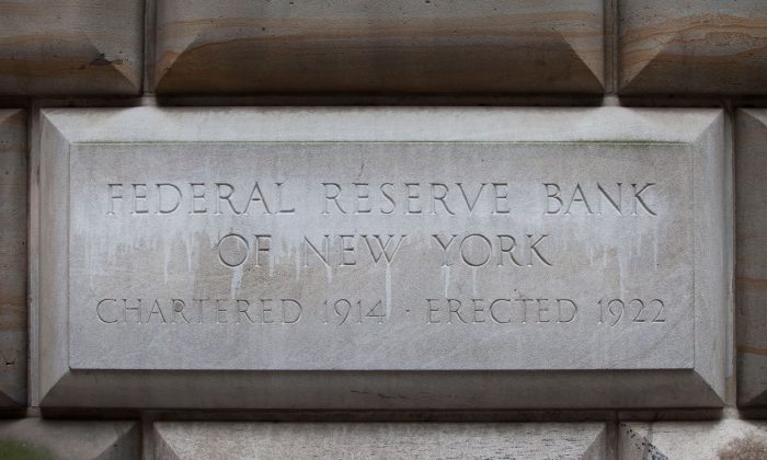A cornerstone in the Federal Reserve Bank of New York building is seen on July 29, 2011 in New York City. (Photo by Andrew Burton/Getty Images)