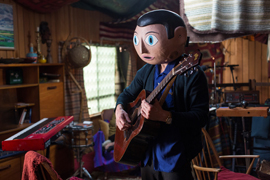 "Michael Fassbender never takes off his papier-mâché head in ""Frank."" (Magnolia Pictures)"