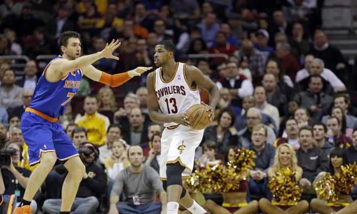 New York Knicks' Andrea Bargnani, from Italy, defends Cleveland Cavaliers' Tristan Thompson (13) in an NBA basketball game Tuesday, Dec. 10, 2013, in Cleveland. (AP Photo/Mark Duncan)