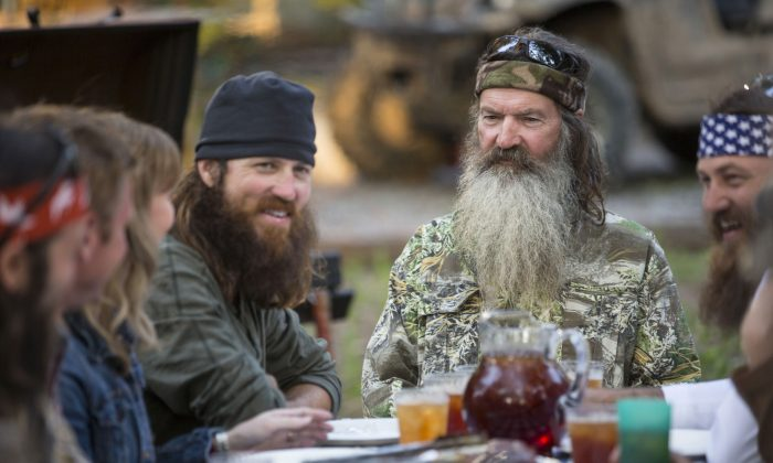 "Phil Robertson, flanked by his sons Jase Robertson, left, and Willie Robertson from the popular series ""Duck Dynasty."" (AP Photo/A&E, Zach Dilgard)"