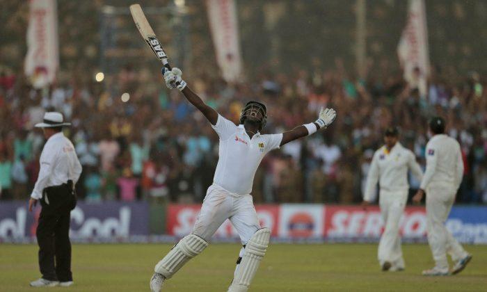 Sri Lankan cricket captain Angelo Mathews celebrates after scoring the winning run against Pakistan during their first test cricket match in Galle, Sri Lanka, Sunday, Aug.10, 2014. Sri Lanka won by seven wickets. (AP Photo/Eranga Jayawardena)