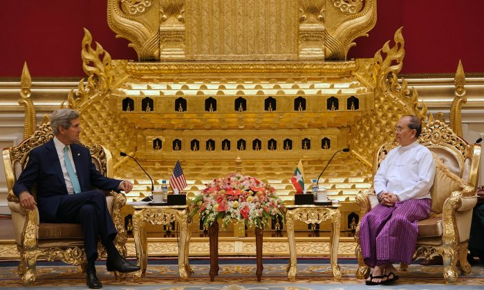 U.S. Secretary of State John Kerry (L) speaks with Burma President Thein Sein during their meeting at the Presidential hall outside the venue of the 47th ASEAN Foreign Ministers' Meeting in Naypyidaw, Burma, on Aug. 9, 2014. (Nicolas Asfouri/AFP/Getty Images)