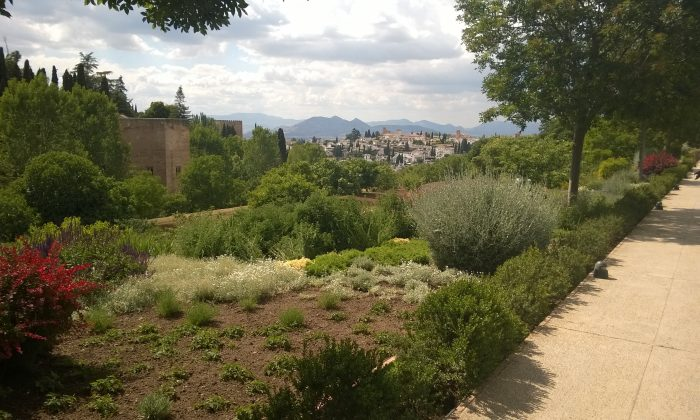 View from Alhambra's garden, with Granada city and the Sierra Nevada mountain range in the background. (Ilya Rzhevskiy/Epoch Times)