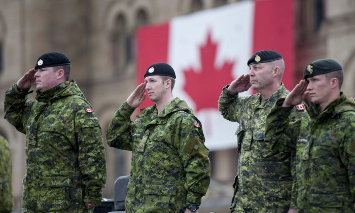 Canadian Forces members salute during the National Day of Honour on Parliament Hill on May 9, 2014. A new Statistics Canada study has found that mental health issues among members of the Canadian Forces have risen substantially in the past 12 years. (The Canadian Press/Justin Tang)