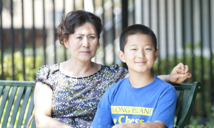 Geng He, wife of Chinese rights lawyer Gao Zhisheng, and their son, Tianyu, in the Bay Area, Calif., on Aug. 5. (Ma Youzhi/Epoch Times)