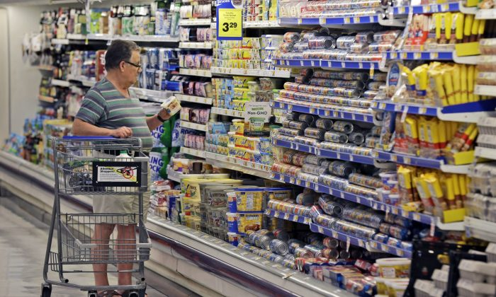 The average Canadian spends more on a long list of taxes than they do on necessities such as housing and food, according to a new study. (AP Photo/LM Otero)