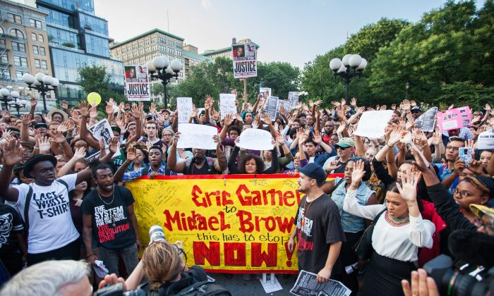 People protest at Union Square in Manhattan, New York on Aug. 14, 2014, in reaction to the police shooting of Missouri teen Michael Brown (Petr Svab/Epoch Times)
