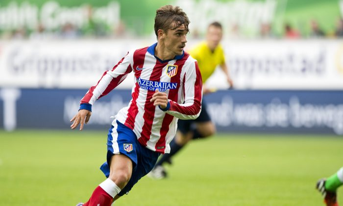 Atletico Madrid's French forward Antoine Griezmann runs with the ball during the pre-season friendly football match of German first division Bundesliga football club VfL Wolfsburg vs La Liga club Atletico Madrid in Wolfsburg, central Germany, on August 10, 2014. (JOHN MACDOUGALL/AFP/Getty Images)