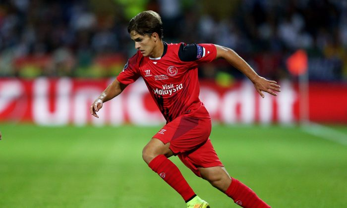 Denis Suarez of Sevilla runs with the ball during the UEFA Super Cup between Real Madrid and Sevilla FC at Cardiff City Stadium on August 12, 2014 in Cardiff, Wales. (Photo by Clive Mason/Getty Images)