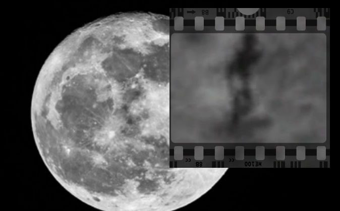 A shadowy figure said by some to resemble an extraterrestrial, said by others to be a glitch in NASA's imaging or explainable by other means. (Screenshot/Google Moon/Background image of moon via Thinkstock)
