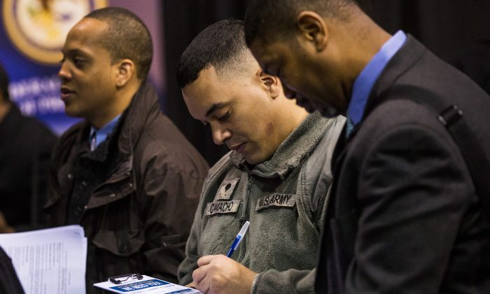 Veterans speak to a job recruiter at a 'Hiring our Heroes' Job Fair on March 27, 2014 in New York City. (Andrew Burton/Getty Images)