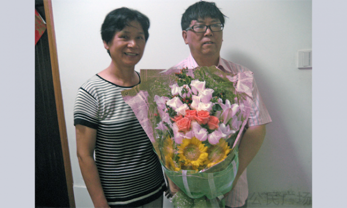 Lü Gengsong and his wife, Wang Xue'e, after his release from prison in August 2011. Lü, a veteran Chinese democracy activist and scholar, has been charged with subverting state power and faces additional prison time. (Chinese Human Rights Defenders)