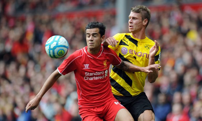 Philippe Coutinho of Liverpool and Lukasz Piszczek of Borussia Dortmund battle for the ball during the Pre Season Friendly match between Liverpool and Borussia Dortmund at Anfield on August 10, 2014 in Liverpool, England. (Photo by Clint Hughes/Getty Images)