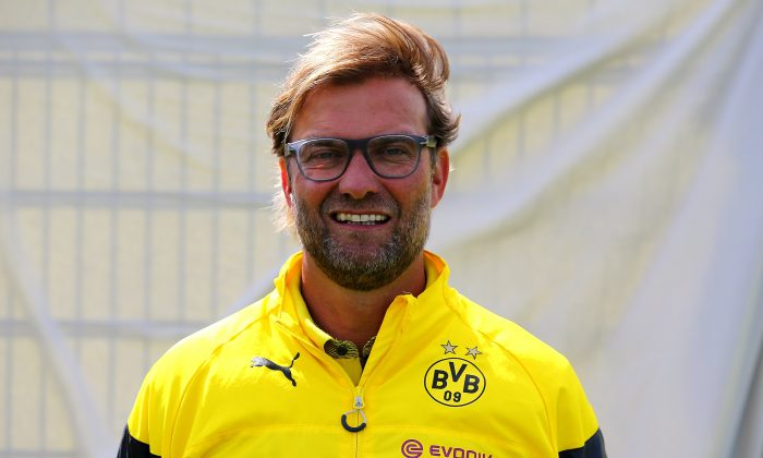 Head coach Juergen Klopp poses during the Borussia Dortmund team presentation at Brackel training ground on August 11, 2014 in Dortmund, Germany. (Photo by Christof Koepsel/Bongarts/Getty Images)