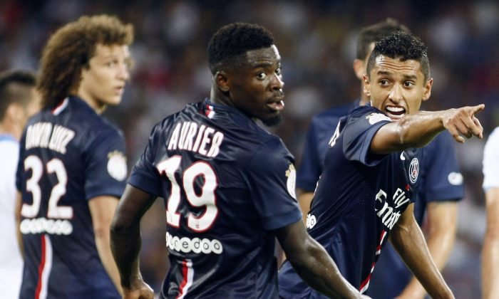Paris Saint-Germain's Brazilian defender Marquinhos (L) gestures as Paris Saint-Germain's Ivorian defender Serge Aurier (C) looks back during the friendly football match between SSC Napoli and Paris Saint-Germain FC as part of the 2014 Acqua Lete Cup, on August 11, 2014 at the San Paolo Stadium, in Naples. (CARLO HERMANN/AFP/Getty Images)