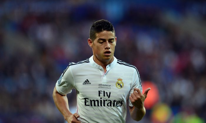 Real Madrids Colombian forward James Rodriguez during the UEFA Super Cup football match between Real Madrid and Sevilla at Cardiff City Stadium in Cardiff, south Wales on August 12, 2014. Cristiano Ronaldo upstaged new team-mates Toni Kroos and James Rodriguez and homecoming hero Gareth Bale as Real Madrid beat Sevilla 2-0 in Cardiff on Tuesday to win the UEFA Super Cup. (CARL COURT/AFP/Getty Images)