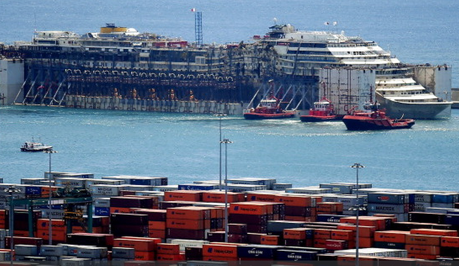 The wreck of the Costa Concordia on arrival in Genoa, on July 27, 2014. A search is continuing for the body of Russell Rebello, who worked as a waiter on the vessel. In a few days the dismantling of the wreck will begin. (Marco Bertorello / AFP / Getty Images)