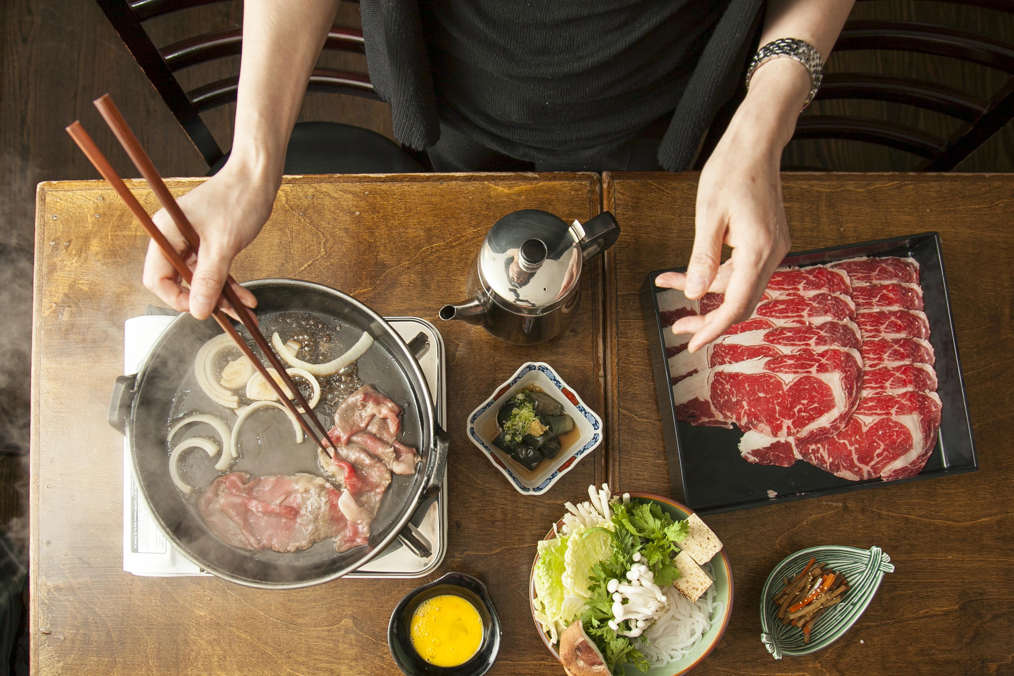 Momokawa owner and chef Mie Okuda cooking sukiyaki.