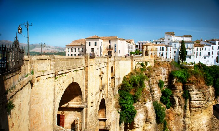 View of the old city of Ronda, the famous white village and the New Bridge. Province of Malaga, Andalusia, Spain. (*Shutterstock)