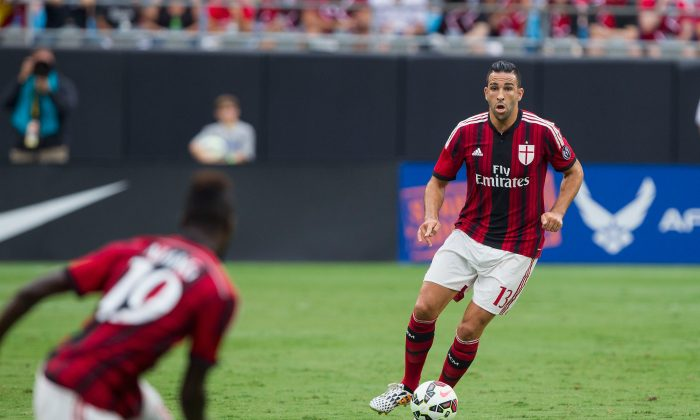 Adil Mai #13 of A.C. Milan passes the ball during first half action against Liverpool in the Guinness International Champions Cup at Bank of America Stadium on August 2, 2014 in Charlotte, North Carolina. Liverpool defeated A.C. Milan 2-0. (Photo by Brian A. Westerholt/Getty Images)