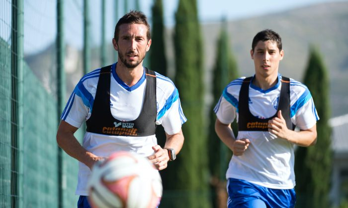 Marseille's French midfielder Morgan Amalfitano (L) and Moroccan midfielder Abdelaziz Barada run during a training session on August 12, 2014 at the Robert Louis-Dreyfus training centre in Marseille, southern France, five days ahead of the French L1 football match Marseille vs Montpellier. (BERTRAND LANGLOIS/AFP/Getty Images)