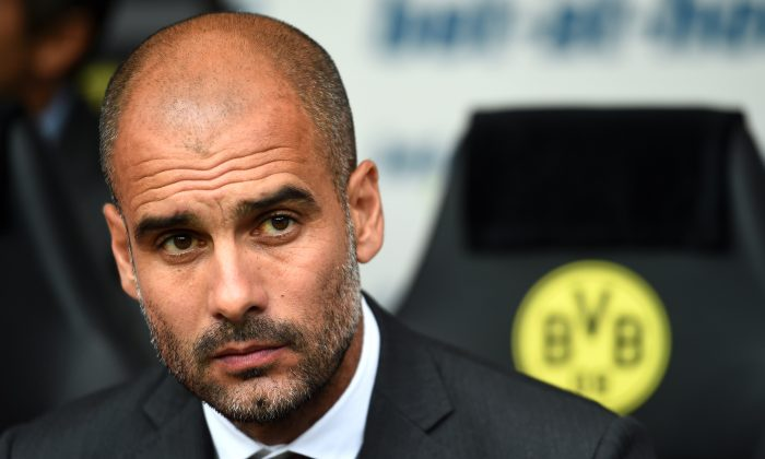Pep Guardiola the manager of Munich looks on during the DFL Supercup between Borrussia Dortmund and FC Bayern Muenchen at Signal Iduna Park on August 13, 2014 in Dortmund, Germany. (Photo by Lars Baron/Bongarts/Getty Images)