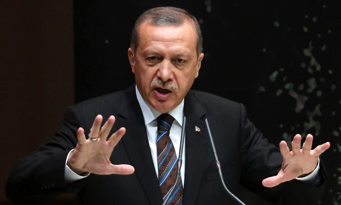 Turkey's Prime Minister Tayyip Erdogan addresses members of his ruling AK Party (AKP) during a meeting at the party headquarters in Ankara on August 14, 2014. (Adem Altan/AFP/Getty Images)