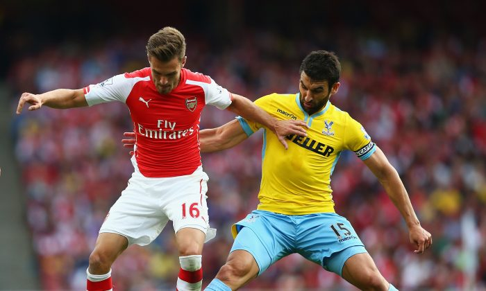 Aaron Ramsey of Arsenal is challenged by Mile Jedinak of Crystal Palace during the Barclays Premier League match between Arsenal and Crystal Palace at Emirates Stadium on August 16, 2014 in London, England. (Photo by Clive Mason/Getty Images)