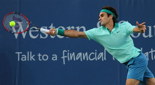 Roger Federer, of Switzerland, returns a serve to Andy Murray, of Britain, at the Western & Southern Open tennis tournament, Friday Aug. 15, 2014, in Mason, Ohio. (AP Photo/Tom Uhlman)