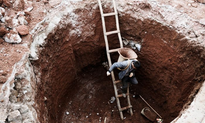 A Chinese farmer makes his way into a dried-up well in Fuyuan, Yunnan Province on Feb. 20, 2012. (STR/AFP/Getty Images)