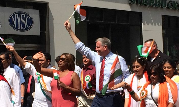 New York City Mayor Bill de Blasio (R) and Public Advocate Tish James (L) in the Indian Day Parade in Midtown Manhattan, New York, on Sunday, August 17, 2014. Mayor Bill de Blasio cemented his image as a mediator and a bridge between disparate communities on Sunday, by attending both Indian and Pakistani Independence celebrations. (Jonathan Zhou/Epoch Times)