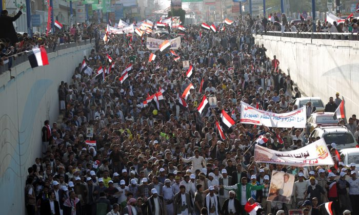 Yemeni protesters wave national flags and banners during a rally in the capital Sanaa on Feb. 8, 2014, marking the 3rd anniversary of the 2011 revolution that forced former President Ali Abdullah Saleh to step down. (Mohammed Huwais/AFP/Getty Images)