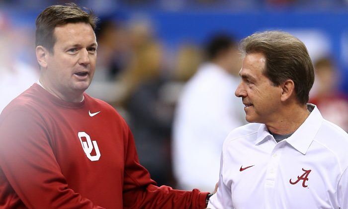 Oklahoma's Bob Stoops shakes hands with Alabama's Nick Saban prior to the Allstate Sugar Bowl on Jan. 2, in New Orleans, La. Stoops and Saban have long been regarded as two of the best coaches in college football. (Streeter Lecka/Getty Images)