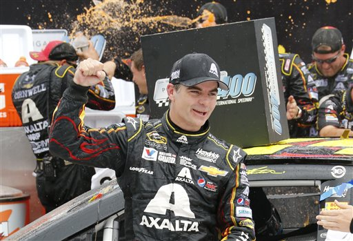 Jeff Gordon celebrates his victory in the NASCAR Sprint Cup Series Pure Michigan 400 auto race at Michigan International Speedway in Brooklyn, Mich., Sunday, Aug. 17, 2014. (AP Photo/Bob Brodbeck)