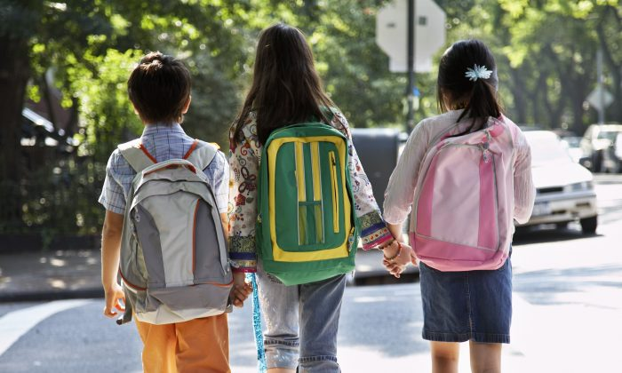A major cause of back pain in children is due to carrying backpacks that are too heavy, too large, or not used properly. (Fuse/Thinkstock)