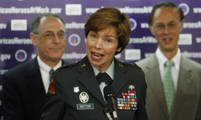 Brigadier General Loree K. Sutton, M.D., director of the Defense Centers of Excellence for Psychological Health and Traumatic Brain Injury, center, speaks at a news conference at the National Press Club in Washington, August 20,2008. (Associated Press/Gerald Herbert)