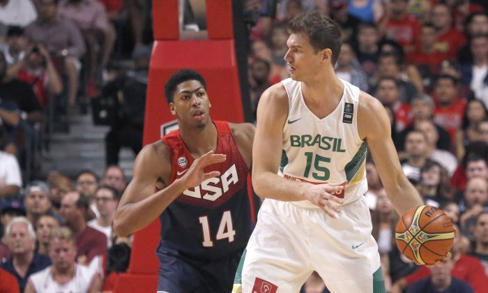 United States' Anthony Davis (14), of the New Orleans Pelicans defends against Brazil's Tiago Splitter (15), of the San Antonio Spurs, during an exhibition game between the US and Brazilian national teams Saturday, Aug. 16, 2014, in Chicago. (AP Photo/Charles Rex Arbogast)