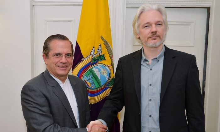 "Ecuador's Foreign Minister Ricardo Patino, left, shakes hands with WikiLeaks founder Julian Assange after a press conference inside the Ecuadorian Embassy in London, Monday Aug. 18, 2014, where Assange confirmed he ""will be leaving the embassy soon"". The Australian Assange fled to the Ecuadorian Embassy in 2012 to escape extradition to Sweden, where he is wanted over allegations of sex crimes. (AP Photo / John Stillwell, POOL)"
