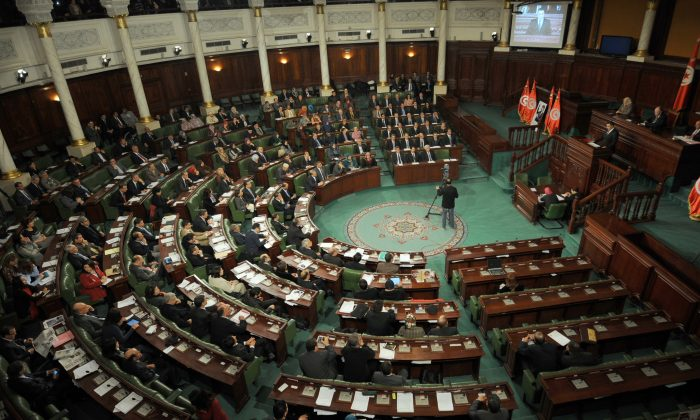 Tunisia's premier-designate Mehdi Jomaa (R) presents his new government during a parliamentary session in the constituent assembly in Tunis on Jan. 28, 2014. Tunisia's leaders the previous day signed the new constitution adopted by lawmakers, a key goal of the revolution three years ago that touched off the Arab Spring. (Fethi Belaid/AFP/Getty Images)
